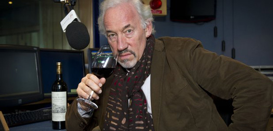 Simon Callow, in a studio, with wine.