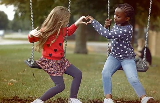 Heart kids on swings