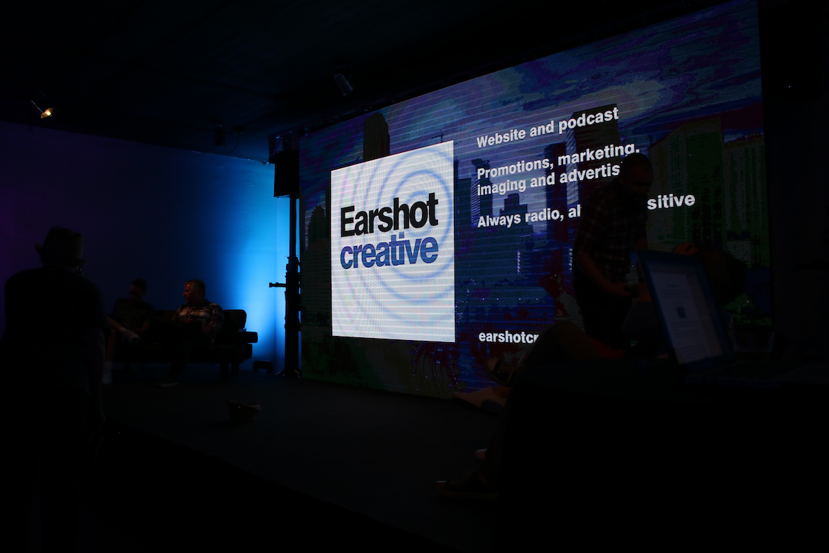 Earshot logo on big screen