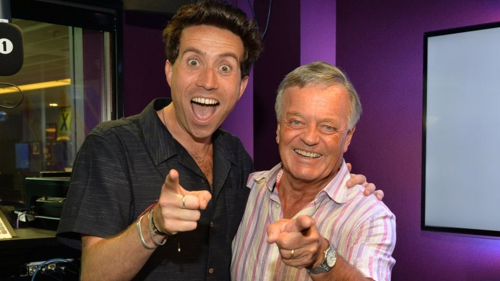 Nick Grimshaw and Tony Blackburn strike the official radio DJ pose.